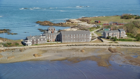 AX143_030.0000157 - Aerial stock photo of An isolated, upscale home by the ocean, Scituate, Massachusetts