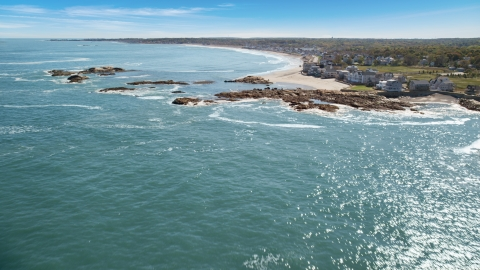 AX143_031.0000000 - Aerial stock photo of Beach and upscale oceanfront homes, Scituate, Massachusetts