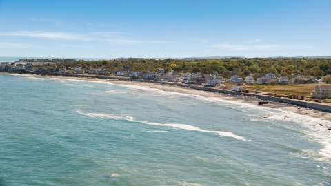 AX143_036.0000206 - Aerial stock photo of A beach and oceanfront homes, Scituate, Massachusetts