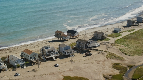 AX143_045.0000066 - Aerial stock photo of Elevated oceanfront homes, Scituate, Massachusetts
