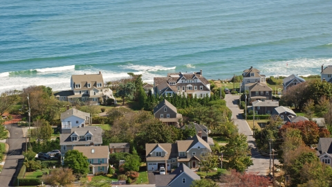 AX143_046.0000154 - Aerial stock photo of A group of upscale oceanfront homes, Scituate, Massachusetts