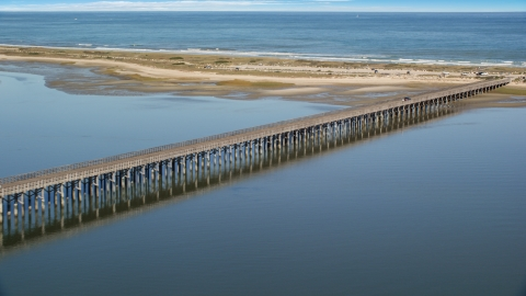 AX143_079.0000000 - Aerial stock photo of The Powder Point Bridge beside a beach, Duxbury, Massachusetts