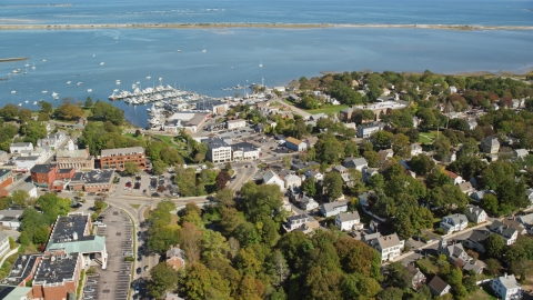 AX143_094.0000227 - Aerial stock photo of A small coastal town by Plymouth Harbor, Plymouth, Massachusetts