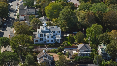 AX143_097.0000076 - Aerial stock photo of A large home in a small town, Plymouth, Massachusetts