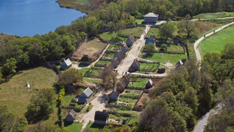 AX143_108.0000118 - Aerial stock photo of Plimoth Plantation near the water in Plymouth, Massachusetts