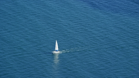 AX143_125.0000000 - Aerial stock photo of A sailing boat on Cape Cod Bay, Massachusetts