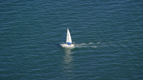 AX143_125.0000349 - Aerial stock photo of A small sailing boat on Cape Cod Bay, Massachusetts