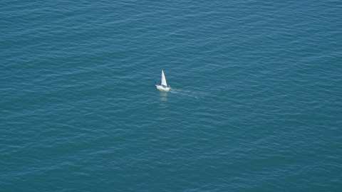 AX143_126.0000181 - Aerial stock photo of A boat sailing on Cape Cod Bay, Massachusetts