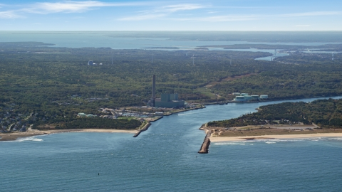 AX143_127.0000139 - Aerial stock photo of A power plant beside Cape Cod Canal, Sandwich, Cape Cod, Massachusetts