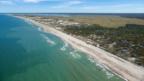 AX143_131.0000105 - Aerial stock photo of A stretch of beach with homes in Barnstable, Massachusetts