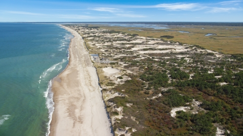 AX143_132.0000000 - Aerial stock photo of A beach and nearby sand dunes, Barnstable, Massachusetts
