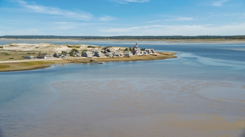 AX143_143.0000000 - Aerial stock photo of Sandy Neck Colony and Sandy Neck Light on Cape Cod, Barnstable, Massachusetts