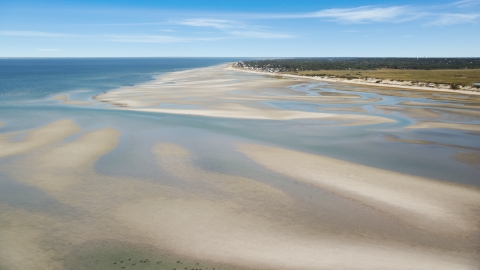 AX143_149.0000000 - Aerial stock photo of Sand bars by small coastal town, Cape Cod, Dennis, Massachusetts
