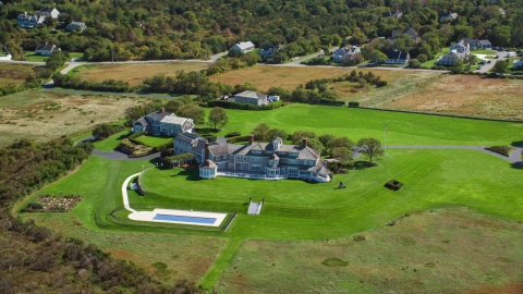 AX143_159.0000272 - Aerial stock photo of A beautiful mansion on Cape Cod, Dennis, Massachusetts