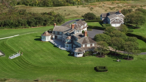 AX143_160.0000204 - Aerial stock photo of A large mansion on Cape Cod, Dennis, Massachusetts