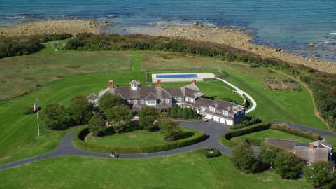 AX143_162.0000193 - Aerial stock photo of A mansion with green lawns on Cape Cod, Dennis, Massachusetts