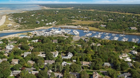 AX143_163.0000000 - Aerial stock photo of Sesuit Harbor and marina on Cape Cod, Dennis, Massachusetts