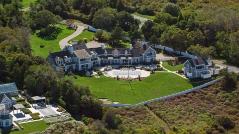 AX143_166.0000251 - Aerial stock photo of A mansion with lush, green lawns, Cape Cod, Dennis, Massachusetts