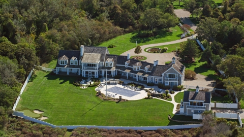 AX143_167.0000143 - Aerial stock photo of A spacious mansion with green lawns on Cape Cod, Dennis, Massachusetts