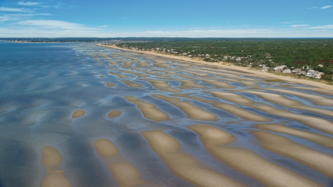AX143_182.0000000 - Aerial stock photo of Sand bars by a small coastal town, Eastham, Massachusetts
