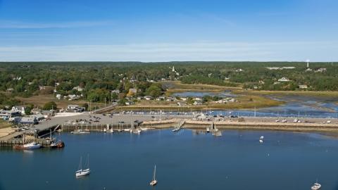 AX143_196.0000000 - Aerial stock photo of Wellfleet Town Pier and a small coastal community, Wellfleet, Massachusetts