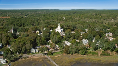 AX143_197.0000247 - Aerial stock photo of A small coastal community and First Congregational Church, Wellfleet, Massachusetts