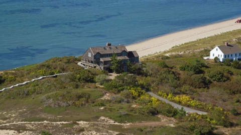 AX143_203.0000000 - Aerial stock photo of An oceanfront home beside a beach, Cape Cod, Truro, Massachusetts