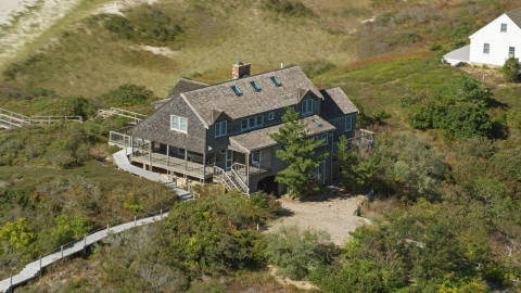 AX143_203.0000134 - Aerial stock photo of A large beachfront home in Cape Cod, Truro, Massachusetts