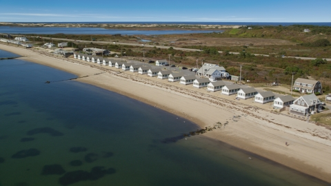 AX143_214.0000246 - Aerial stock photo of Beachside cottages on Cape Cod, Truro, Massachusetts