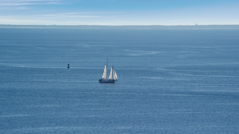 AX143_220.0000000 - Aerial stock photo of A sailing boat in Cape Cod Bay, Massachusetts