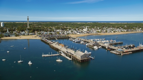 AX143_224.0000000 - Aerial stock photo of Piers and boats near a small coastal town, Provincetown, Massachusetts