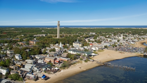 AX143_226.0000024 - Aerial stock photo of The Pilgrim Monument in a small coastal town, Provincetown, Massachusetts