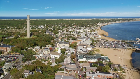 AX143_226.0000243 - Aerial stock photo of The iconic Pilgrim Monument in a small coastal town, Provincetown, Massachusetts