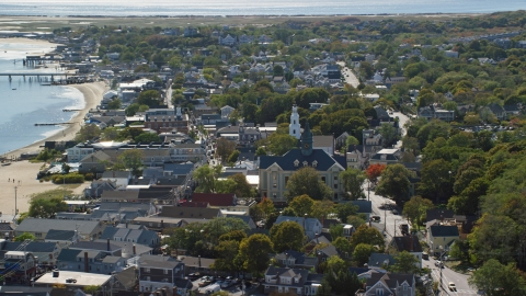 AX143_229.0000310 - Aerial stock photo of Provincetown Town Hall and Unitarian Universalist Meeting House in the coastal town of Provincetown, Massachusetts