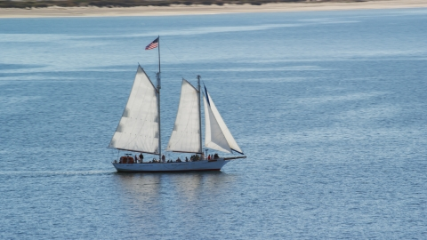 AX143_243.0000000 - Aerial stock photo of A sailing boat on Cape Cod Bay, Massachusetts