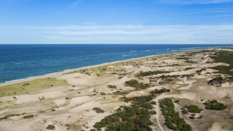 AX144_001.0000313 - Aerial stock photo of Sand dunes and beach on Cape Cod, Provincetown, Massachusetts