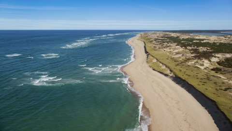 AX144_006.0000043 - Aerial stock photo of A long strip of empty beach, Cape Cod, Provincetown, Massachusetts