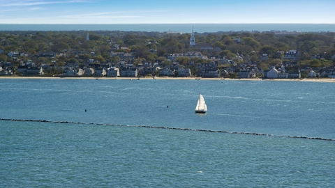 AX144_074.0000000 - Aerial stock photo of A small island town, sailboats on water, Nantucket, Massachusetts