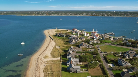 AX144_088.0000000 - Aerial stock photo of Oceanfront homes and Nantucket Harbor Lights, Nantucket, Massachusetts