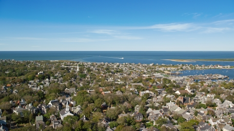 AX144_097.0000000 - Aerial stock photo of A small coastal community with a view of Nantucket Harbor, Nantucket, Massachusetts
