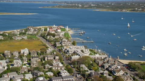 AX144_103.0000129 - Aerial stock photo of Coastal homes by Nantucket Harbor Range Lights, Nantucket, Massachusetts