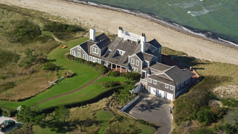 AX144_107.0000277 - Aerial stock photo of An upscale beachfront home in Nantucket, Massachusetts