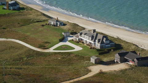 AX144_111.0000000 - Aerial stock photo of An upscale home by the beach in Nantucket, Massachusetts