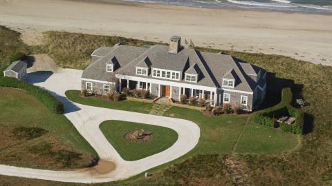 AX144_111.0000154 - Aerial stock photo of A beautiful home by the beach in Nantucket, Massachusetts