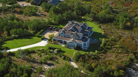 AX144_114.0000020 - Aerial stock photo of An upscale home and green trees, Nantucket, Massachusetts