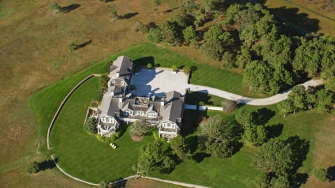 AX144_129.0000086 - Aerial stock photo of A bird's eye view of an isolated mansion on Chappaquiddick Island, Martha's Vineyard, Massachusetts