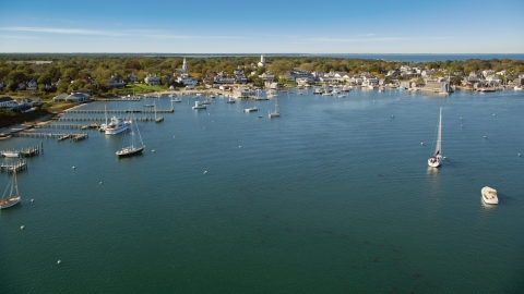 AX144_134.0000107 - Aerial stock photo of Boats moored near piers in Edgartown, Martha's Vineyard, Massachusetts
