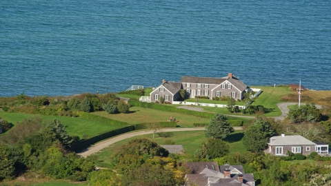 AX144_145.0000000 - Aerial stock photo of An oceanfront home in Edgartown, Martha's Vineyard, Massachusetts
