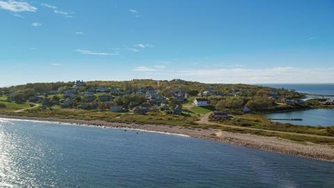 AX144_173.0000000 - Aerial stock photo of A coastal community on Cuttyhunk Island, Elisabeth Islands, Massachusetts