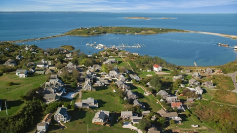 AX144_176.0000114 - Aerial stock photo of A coastal community near pond on Cuttyhunk Island, Elisabeth Islands, Massachusetts